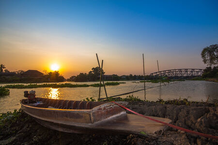 The boat river side sunset time at Nahkon Pathom Thailand photo