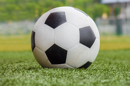 Soccer ball on the grass  green and yellow  photo