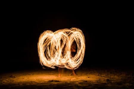 Fire man show a circular motion photo