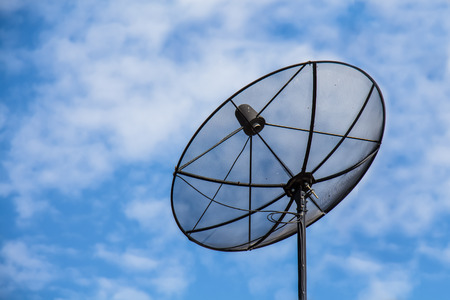 Satellite dish in blue sky and cloud background photo