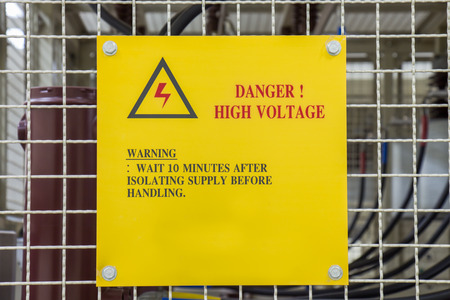 sub station: Metal sign Danger High Voltage for capacitor bank in sub station Stock Photo