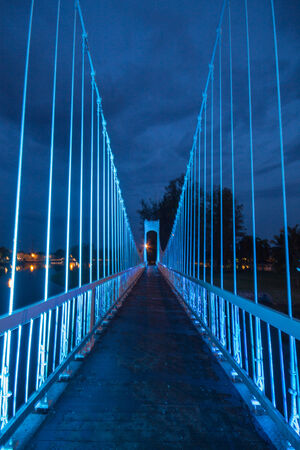 The metal rope bridge  in the park at twilight time photo