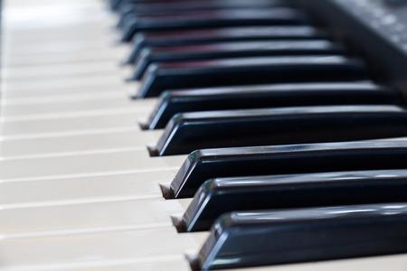 acoustically: background of synthesizer keyboard