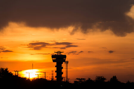 control tower: Flight control tower at airport during sunset