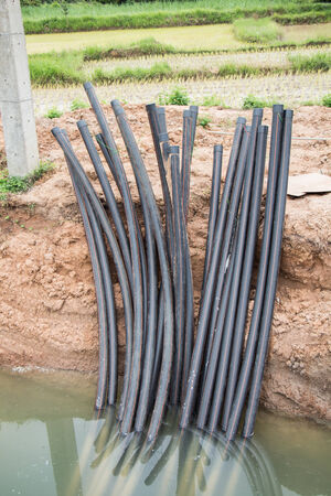 cross linked: Power distribution under ground cable system construction  Through pass under the road Stock Photo