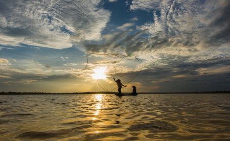 Fishermen fishing by fishnet photo