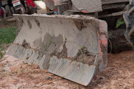 construction plant: Blade of tractor in construction plant