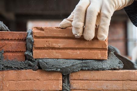 Building brick block wall on construction plant photo