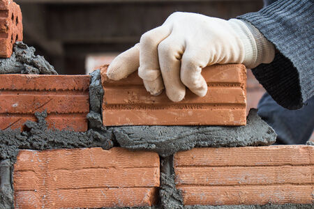 construction plant: Building brick block wall on construction plant