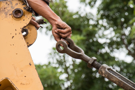 bendable: Man use hand for pulling ropeto connect the machine Stock Photo