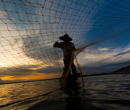 The fisherman living along the Mekong River to Thailand photo