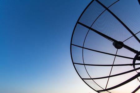 airwaves: satellite dish antenna in the blue sky Stock Photo