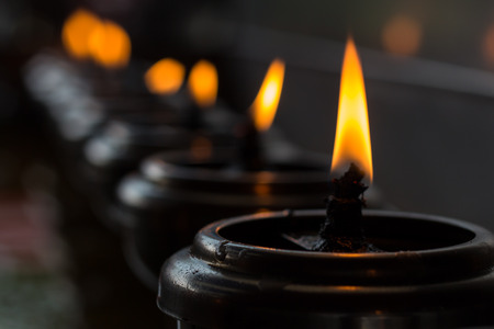 candlelight memorial: Lignting of Praying candles in a temple
