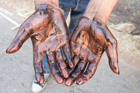 naphtha: Oil stained hands dirty