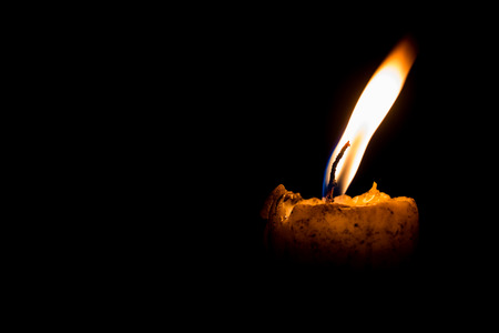 flickering: light of yellow candle at night