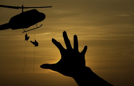 some body need  for helpfrom a military helicopter rescue Stock Photo