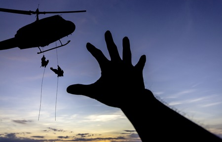 helicopter rescue: some body need  for help  from a military helicopter rescue Stock Photo