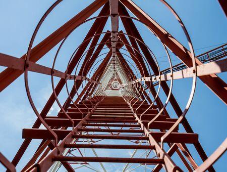 communication tower: Botton view communication tower 73 meter Stock Photo