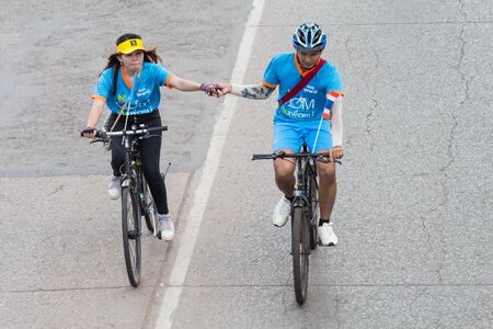 teammates: UDONTHANI,THAILAND - AUG 16:Cycling to celebrate the blast. On the occasion of the anniversary of the Queen of Thailand 83 years old,Event Name Bike for mom,on 16 August, 2015.