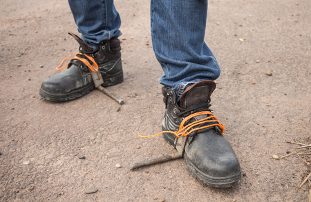 safety shoes: The workers were wearing safety shoes And equipment for climbing a electric pole.