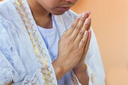 Put the palms of the hands together in salute for prayer in the ceremony was ordained a priest.A man in Thailand at the age of twenty years of age to be ordained for return the goodness to parents