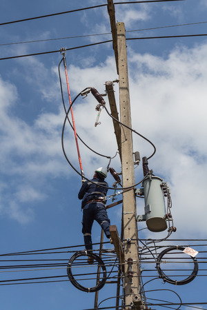 disconnect: Workers are using a disconnect stick tools to disconnect high voltage supply for the transformer.