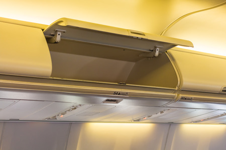 compartment: Overhead compartment in commercial aircraft.