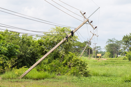 The storm caused severe damage to electric poles falling tilt. 版權商用圖片 - 61114360