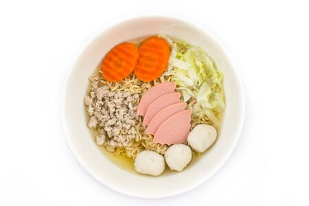 cooked instant noodle: Cook the noodles in a bowl.With condiments such as carrots, cabbage pork bolognese and meatballs. Stock Photo