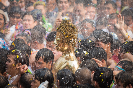Songkran Festival, Many people have raised the buddha statues Luang Pho Phra Sai joined parade to pray closely at Nongkhai Thailand. Editorial