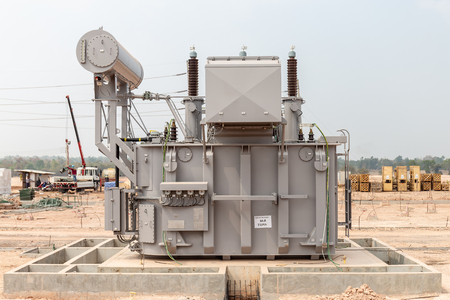 Power transformers are being installed for use in high voltage substations.Back side.