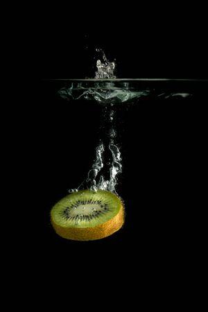 Kiwi fresh fruit slice fall underwater