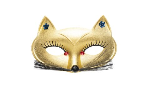 Golden fancy cat carnival mask with red beads and moustache isolated on a white background