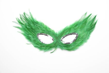 Fancy green feather mask with silver beads isolated in white background