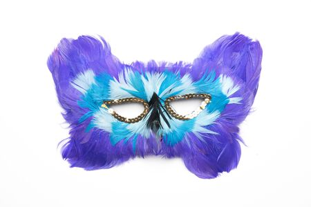 Purple blue white carnival mask with feathers isolated on a white background