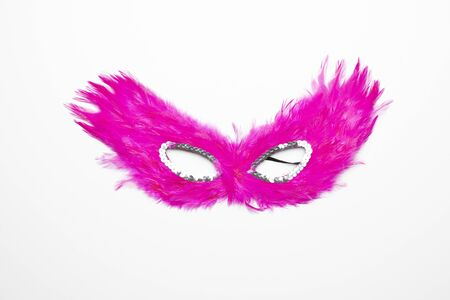 Fancy pink feather mask with silver beads isolated in white background