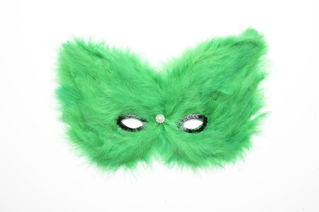 Green hairy carnival mask isolated on white background
