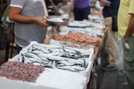 fish selling: Selling fresh fish in the fish market Stock Photo
