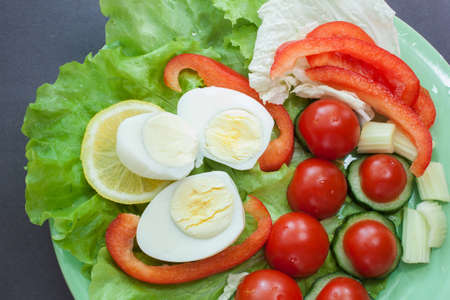 Healthy eating - fresh vegetables with sliced eggs closeup photo