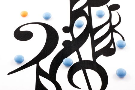 Music notation elements and pills on white background photo