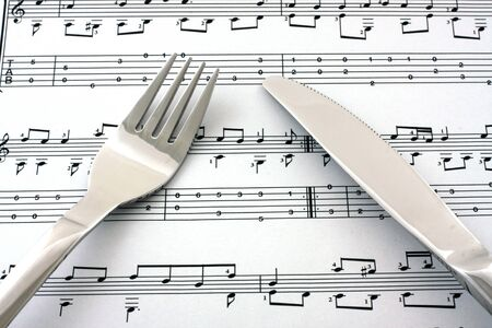 bass clef: Sheet of notes with fork and knife