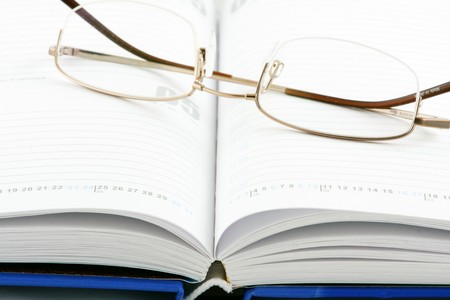 Notepad & glasses Stock Photo - 7934279
