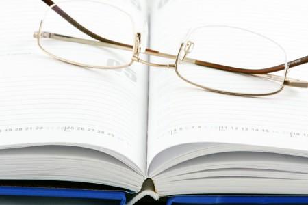Notepad & glasses Stock Photo - 7934279
