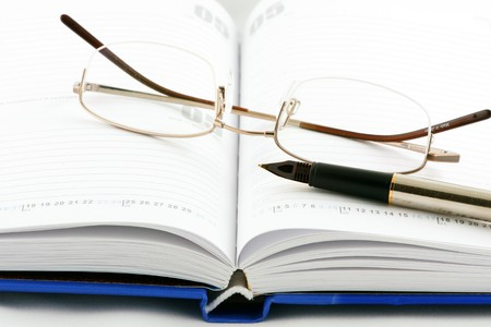 Notepad, pen & glasses photo