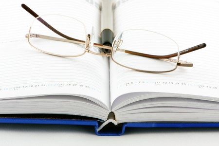 Notepad, pen & glasses Stock Photo - 7934302