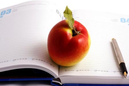 Notepad, pen & apple photo