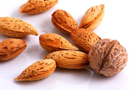 Walnuts and Almonds. Close-up. Stock Photo - 7934342