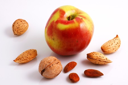 protien: Walnuts, Almonds and Apple Stock Photo