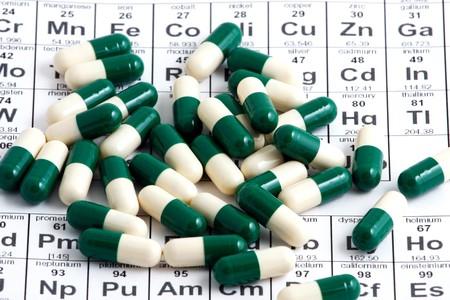 anesthetize: Macro of pills lying on periodic table Stock Photo