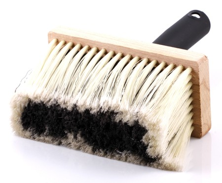 Brush for cleaning isolated on a white background photo